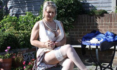 Big Breasted Mature Slut Playing in the Garden - Mature.nl