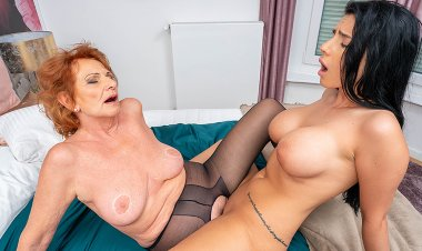Grandma and busty young girl lick each other's pussies