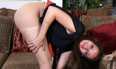 Naughty American Mom Playing on the Couch - Mature.nl