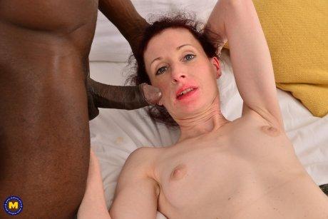 Horny British mature lady munching on a big black cock