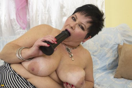 Big breasted mature BBW playing all alone